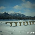Hiking on ice and snow to taushubetsu river bridge